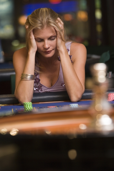 2124369-woman-losing-at-roulette-table